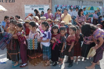 The assortment of colors and patterns in the children's traje was a beautiful sight to behold! Because of this special event, the children were dressed in their fanciest clothes.