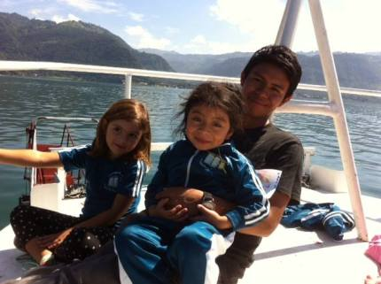 Chloe, Ceci, and Profesor Gaspar on the top leve of the boat across the lake