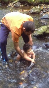 Playing in the river - 5 months