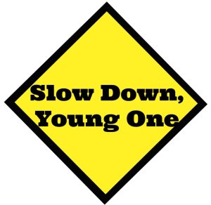 slow down, young one - caution sign