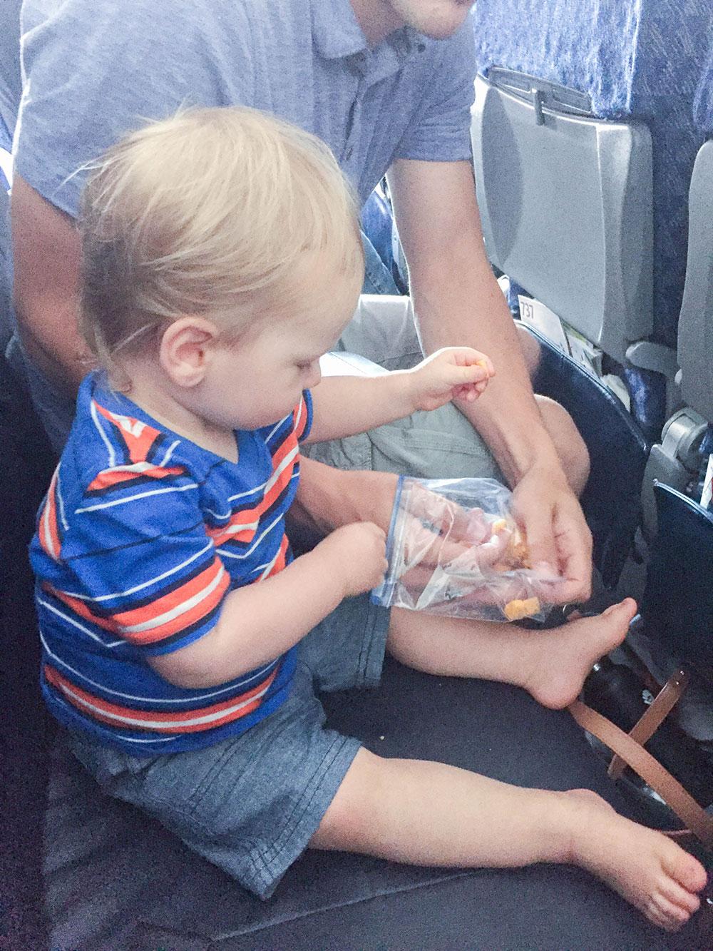 toddler traveling on flight