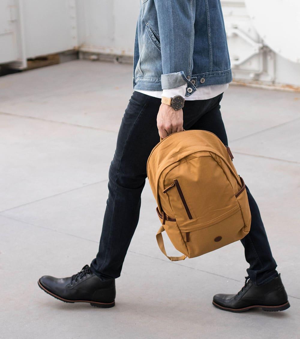 Walking with Timerberland Bag