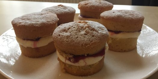 Five miniature Victoria Sponge cakes on a plate
