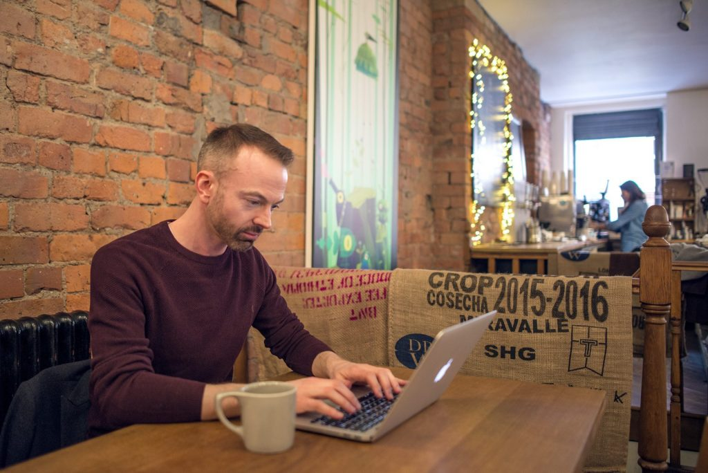 Image of executive coach and career coach Chris Cooper working in a Manchester city centre cafe