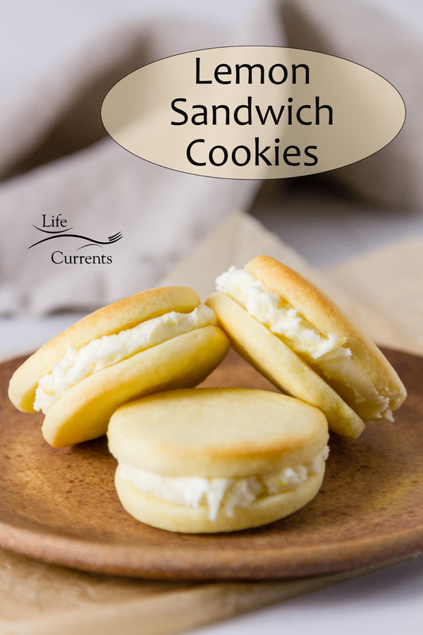 Lemon Sandwich Cookies: title on image. 3 cookies stacked on a brown plate