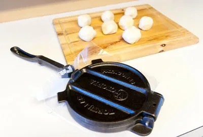 Homemade tortillas encase fillings like Seasoned Black Bean Mash, Verde Queso Fun-dito, and Homemade Guacamole. step4Tortillas