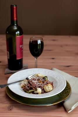 Red wine pasta with Roasted Cauliflower and Broccoli Topped with Pine Nuts and Grated Parmesan