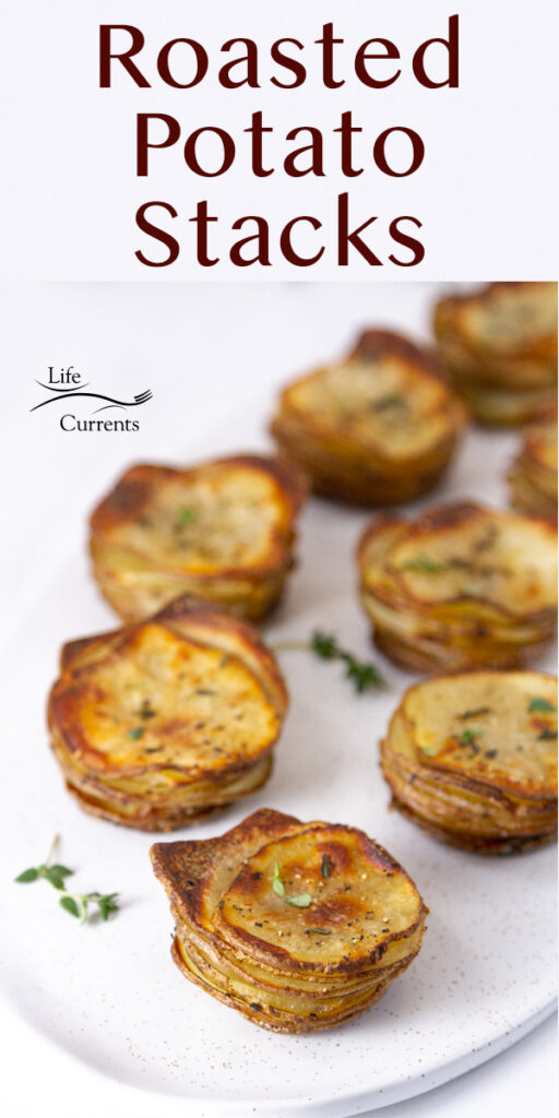 several potato stacks on a white serving platter with fresh thyme around, title on image: Roasted Potato Stacks