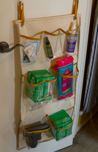 custome made DIY organizer for behind the door: ironing board hangers: Broom Closet Makeover #organizing #organize #clean Life Currents