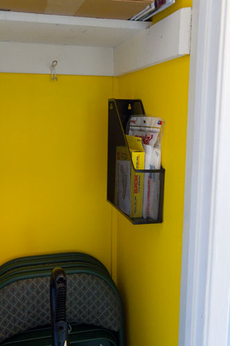 magazine rack: ironing board hangers: Broom Closet Makeover  #organizing #organize #clean Life Currents