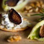 blue cheese spread on crackers with figs