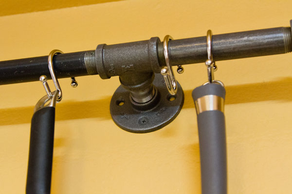 DIY pot rack made from pipes The flanges attach to the wall into the studs.