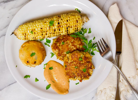dinner of Tuna Cakes with Comeback Sauce, Corn on the Cob, and Biscuits