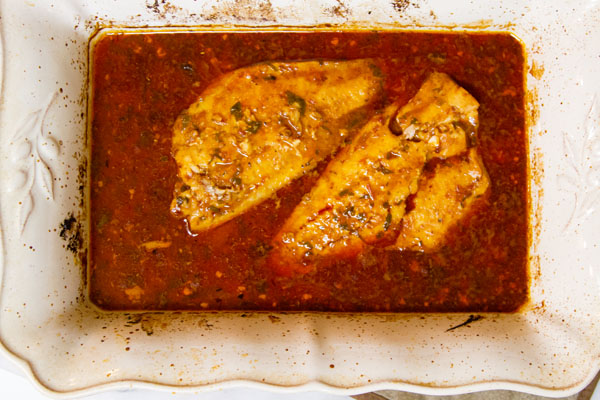 Spicy Cajun Cod: Savory, spicy, fish that you can't quit eating...use crusty, bread to sop up every last drop of the delicious sauce! This fish could easily be a weeknight meal as well.