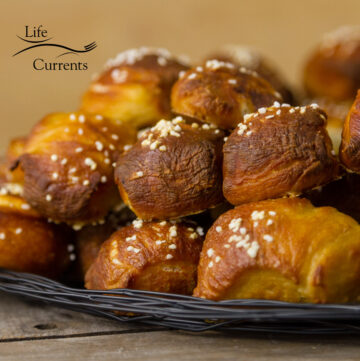 square crop of pretzel bites stacked on a serving plate.