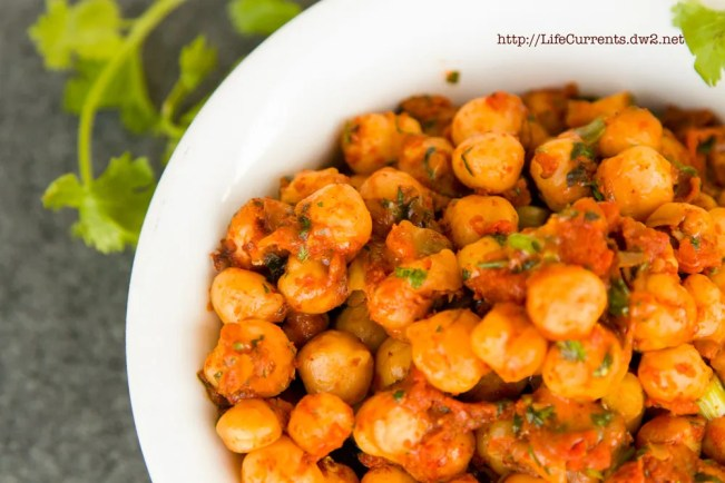 Nacho Roasted Chickpeas in a white bowl with cilantro leaves