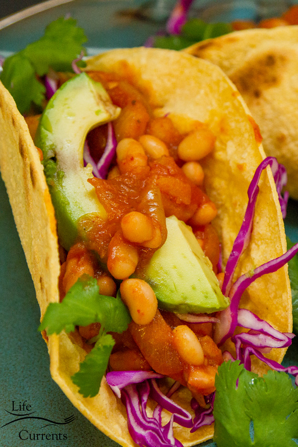 White Bean - Potato Tacos are super yummy, with a hint of smoky chipotle. The sauce is well-rounded with sweet and tangy white onions, tomato paste, and a little sugar. And, they have that creaminess that potatoes and white beans give.