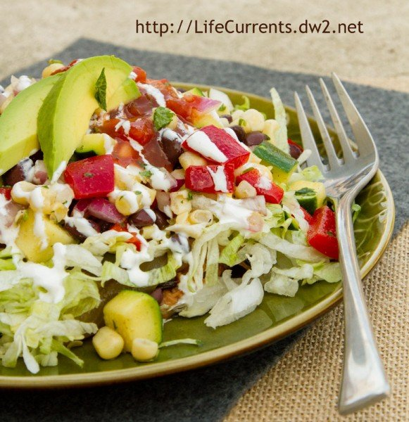 Mexican Corn Salad on top of Tostada with Mexican Corn Salad | Life Currents