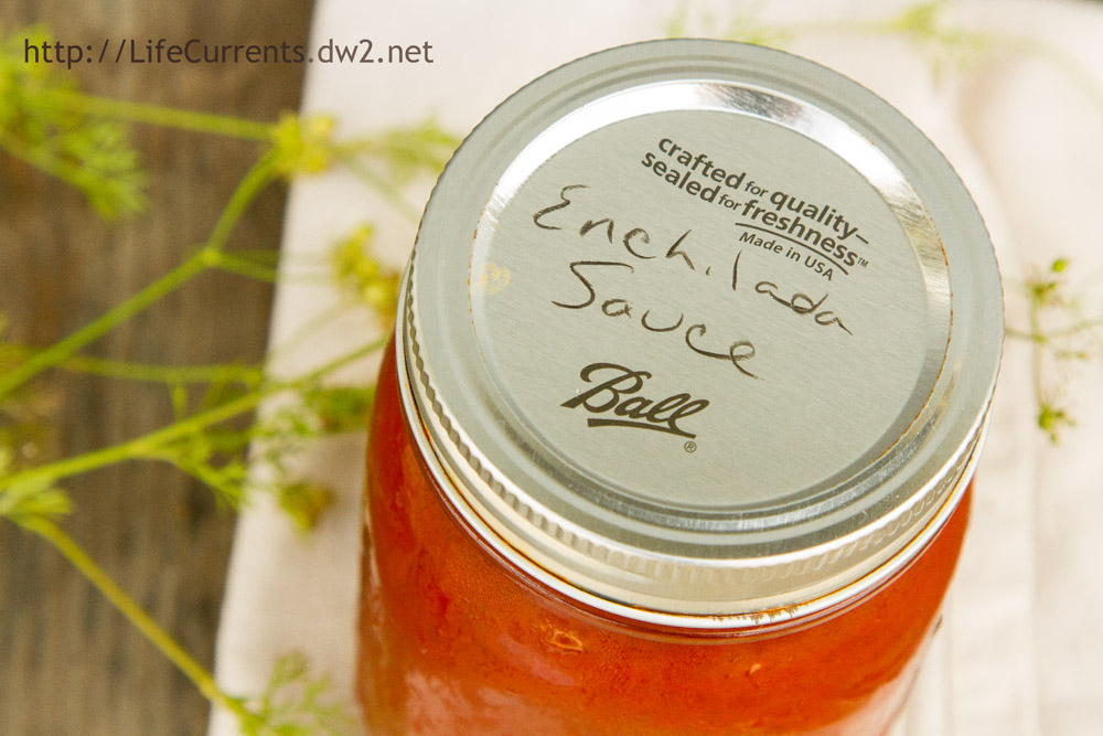 the lid of the enchilada sauce has been writen on to indicate what's inside