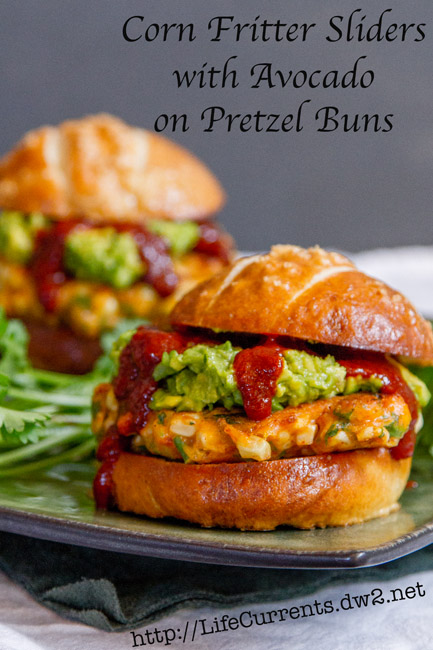 Corn Fritter Sliders with Avocado and Enchilada Sauce on Pretzel Buns | Life Currents https://lifecurrentsblog.com