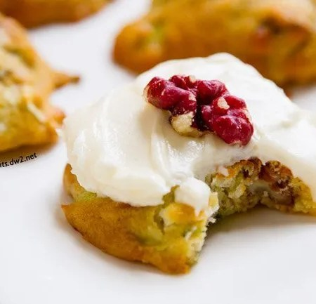 Zucchini Cookies with Cream Cheese Frosting are filling with yummy ingredients like walnuts, coconut, and zucchini. Have them for a snack or even for breakfast! by Life Currents http://LifeCurrents.dw2.net