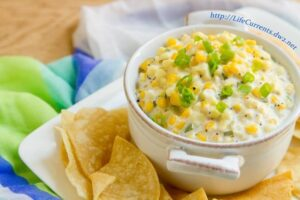 Crock Pot Corn Dip is a creamy dreamy (and easy) dip to make for your next party. Your guests won't be able to stop eating it!