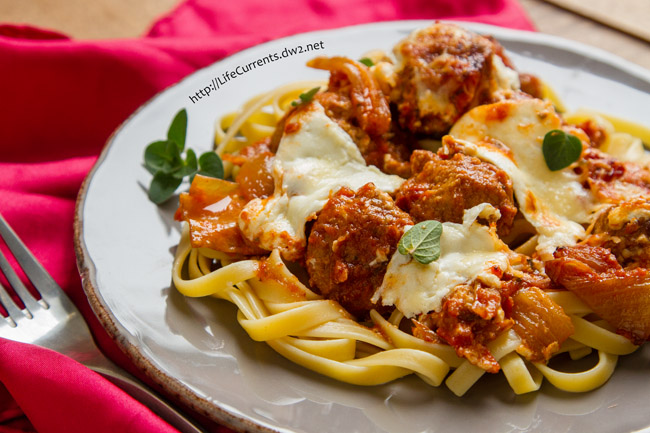 Baked Meatballs in Balsamic Tomato Sauce.. a full flavored rich tomato sauce, topped with melty gooey fresh mozzarella, it's Italian food, kicked up a notch or two! from Life Currents https://lifecurrentsblog.com