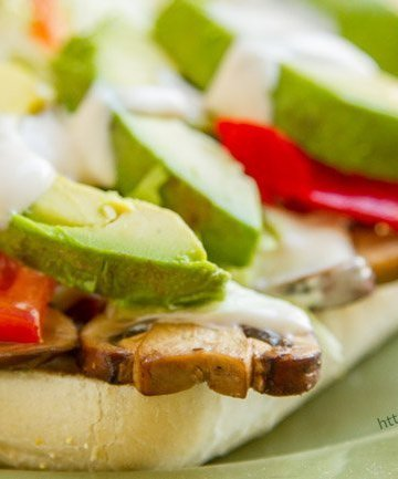 Hot Vegetarian Italian Sandwich -- filled with goodies like sauteed mushrooms, peppers, tomatoes, avocado, lettuce, and all topped off with creamy Alfredo Sauce is a total hit! https://lifecurrentsblog.com