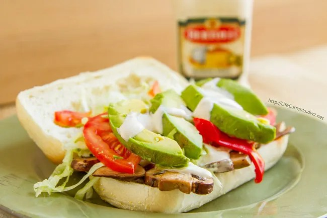Hot Vegetarian Italian Sub -- filled with goodies like sauteed mushrooms, peppers, tomatoes, avocado, lettuce, and all topped off with creamy Alfredo Sauce is a total hit! https://lifecurrentsblog.com