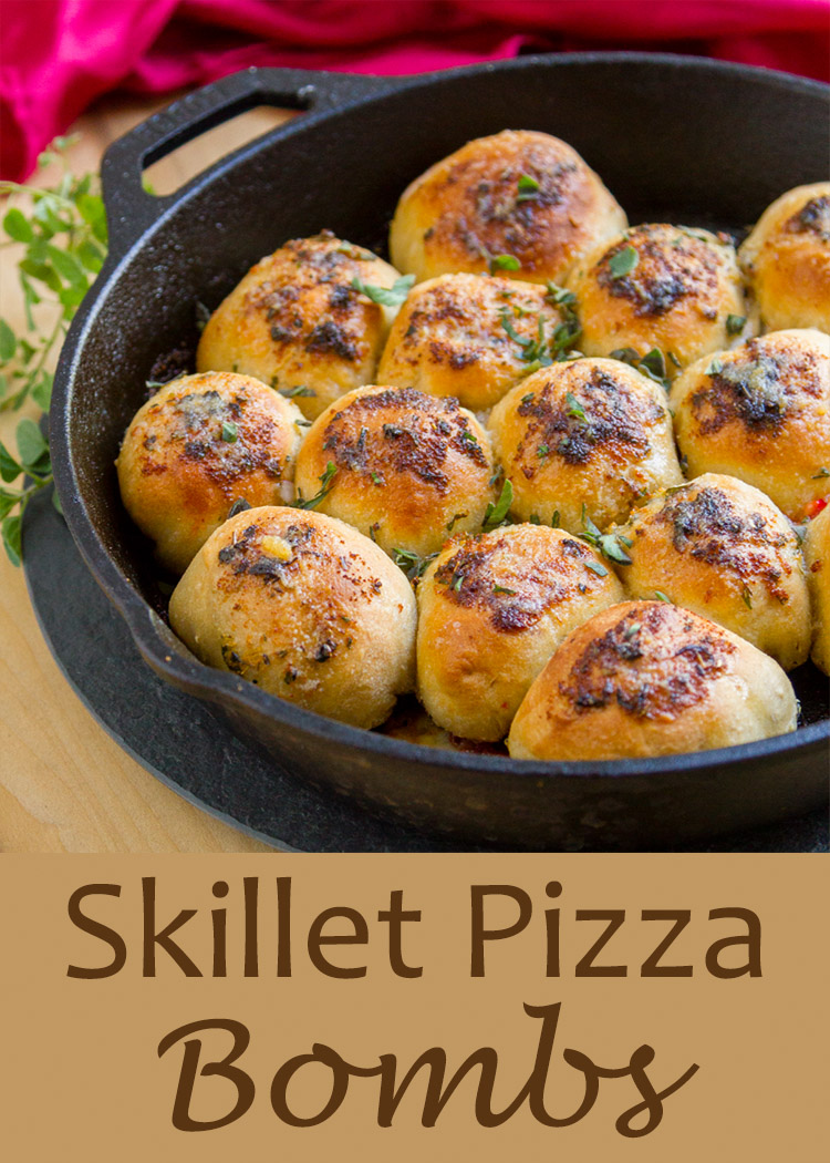 Skillet Pizza Bombs are loaded with yummy pizza fillings and topped with herbed garlic butter, then baked to yummy goodness