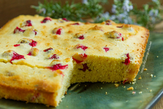 Cranberry Rosemary Cornbread - sweet old-fashioned cornbread with tart cranberries mixed in, and a little earthy rosemary to top it all off - the perfect festive and delicious side dish at the holidays