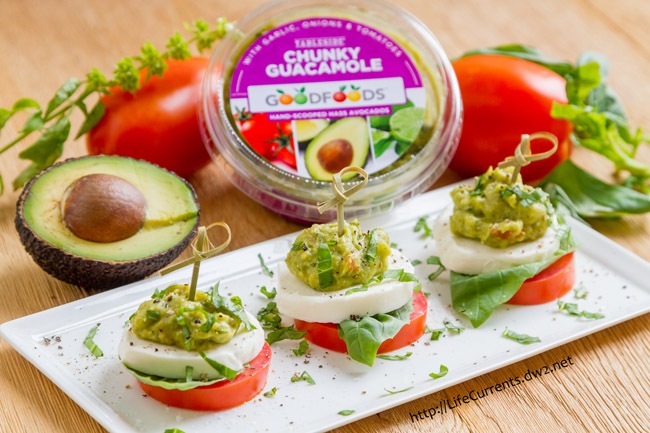 Super easy to make, and Caprese is one of my favorite combinations of flavors (mmm, fresh mozzarella, tart tomatoes, fresh basil - yum!), these Guacamole Caprese Bites will be the toast of the party!