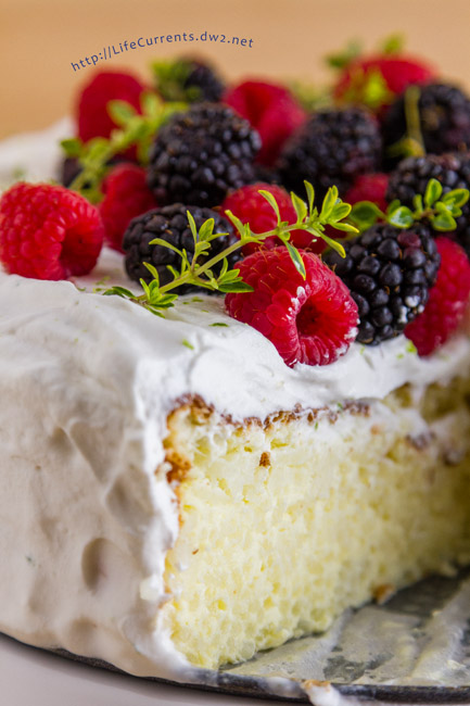 Fragrant Jasmine Rice Cake - pretty gluten-free celebration cake with its fragrant cardamom and lime scented rice pudding insides all crowned with lime whipped cream and fresh berries - the perfect dessert or breakfast