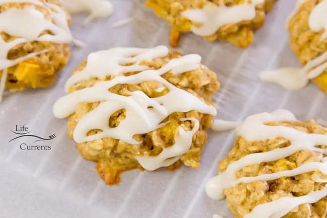 Peach Cobbler Cookies are a perfect summer treat, made with fresh juicy peaches and drizzled with vanilla icing!
