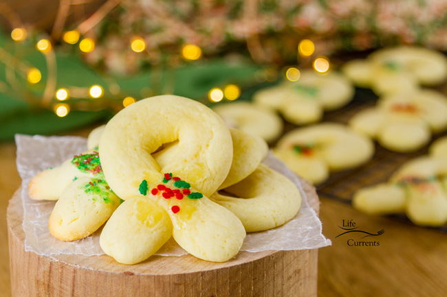 Berliner Kranz Cookies - traditionally made into wreath shapes and decorated with some little bit of red and green sugars