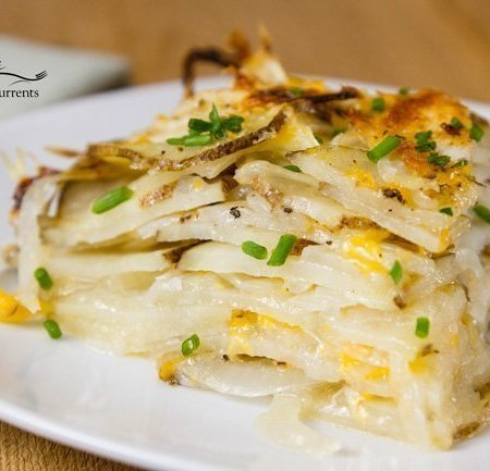 Skinny Potato and Onion Bake Earthy potatoes layered with flavorful and aromatic onions. All in a light cheesy sauce.