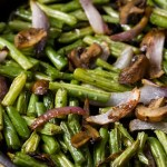 Easy Roasted Green Beans with Mushrooms and Onions - roasted veggies in a cast iron skillet waiting to be eaten!