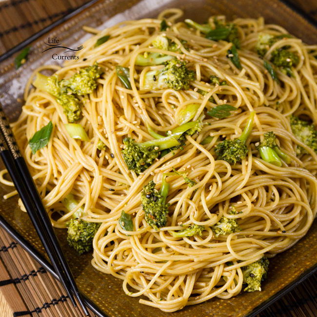 Garlic Sesame Noodles - square image with Asian noodles on a plate with chopsticks