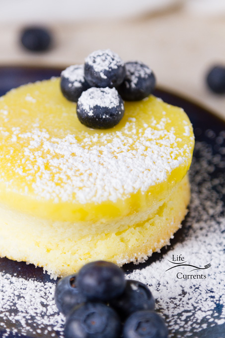 Lemon Soufflé Magic Cakes are light and airy sponge cakes topped with a lemon curd pudding - one batter that magically separates while it bakes!