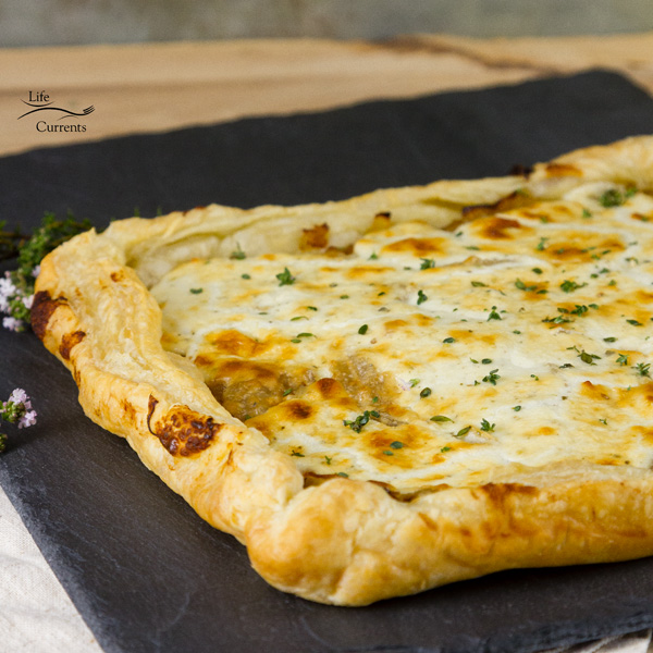 French Onion Tart - Sweet caramelized onions topped with earthy goat cheese, and all baked up in a flakey delicious puff pastry tart.