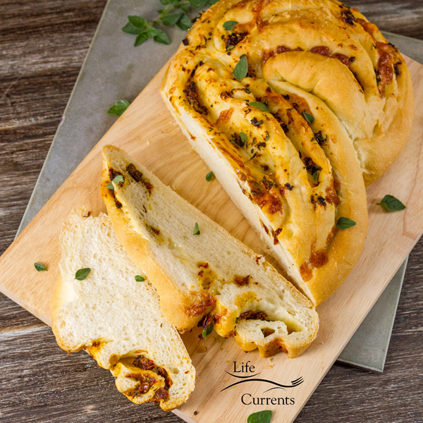 Garlic, Tomato, and Cheese Twisted Yeast Bread has a beautifully soft, fluffy texture with perfect little air pockets in the bread.