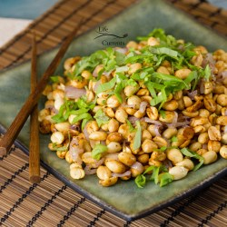 Fried Peanuts with garlic and basil are suitable as snack for any occasion. These treats are vegan and gluten-free. And, they are easy to make.
