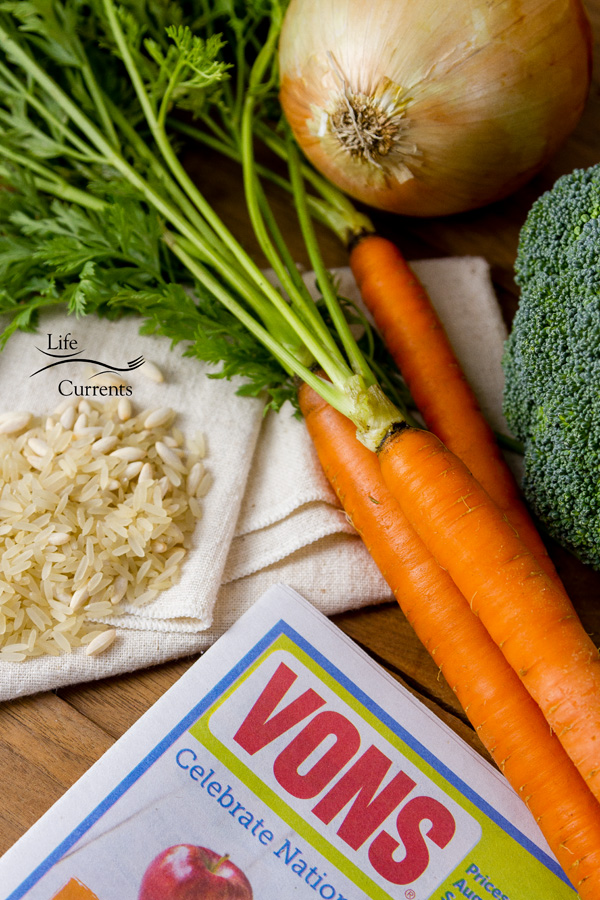 uncooked rice, carrots, broccoli, and the Vons newspaper ad.