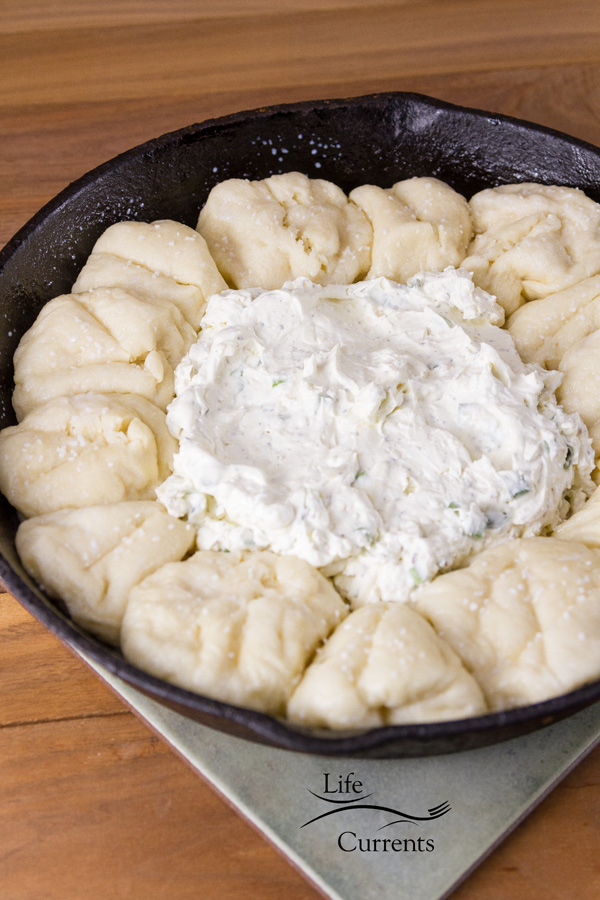 Skillet Pull-Apart Pretzel Buns with Creamy Cheese Dip - assembly