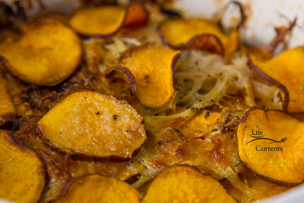 With layers of thin sweet potatoes and a quick light cheese sauce that's made as the casserole bakes, this great Sweet Potato Layer Bake side dish is pretty enough for guests, and easy enough for any day of the week!