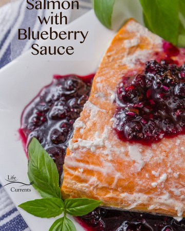 Salmon with Blueberry Sauce - Salmon fillets wrapped in a parchment paper pouch (en papillote) and baked in the oven, then topped with a special blueberry conserve that's made especially for garnishing fresh salmon.