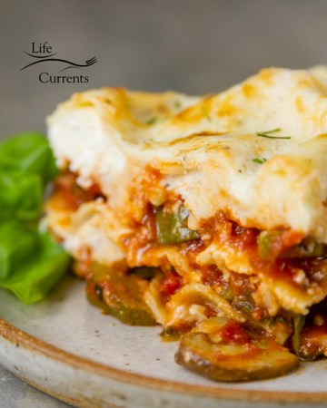 Vegetarian Vegetable Lasagna Recipe With lots of healthy vegetables including zucchini, red peppers, mushrooms, carrots, onion, and tomatoes, all topped with a lovely white sauce, this lasagna is flavorful, but not at all heavy.