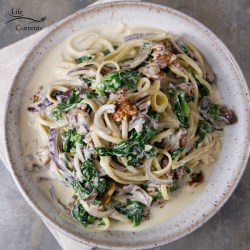 I served this Blue Cheese Spinach Walnut Sauce over linguini pasta. Oh and it's so good! But you can also serve it over any protein like chicken or steak