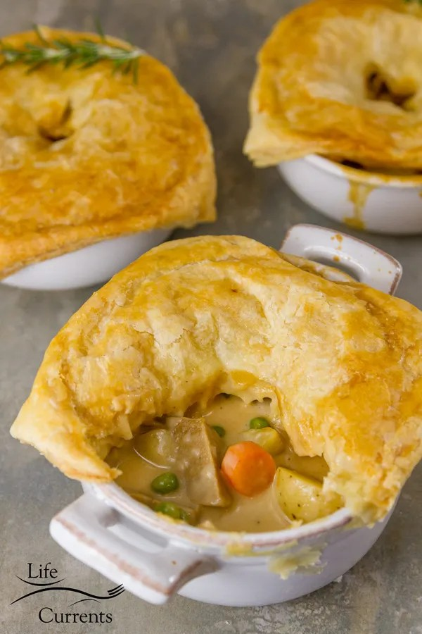 Sausage and Potato Pot Pie - Amazingly delicious individual pot pies filled with sausage, potatoes, carrots, peas, and a creamy gravy