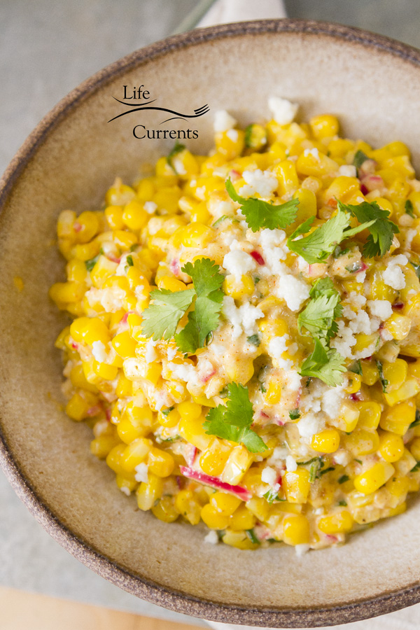 Mexican Street Corn Salad (esquites) -- It's a perfect appetizer; serve it with chips like salsa. I brought this dish to the Memorial Day pool party, and it was gone in a flash!